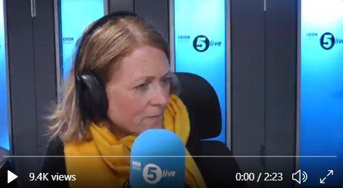 Radio 5 presenter talking into large blue microphone